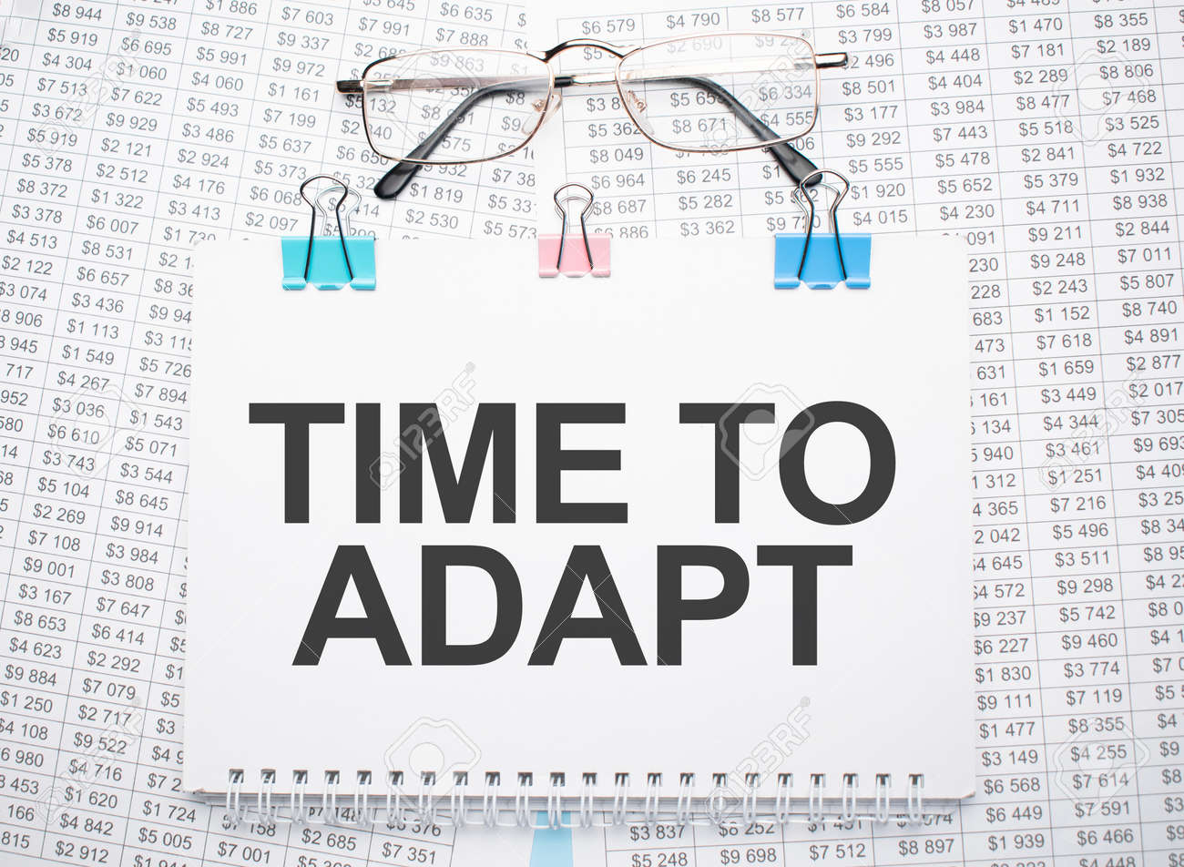 TIME TO ADAPT text written on paper with pen and glasses - 173913488