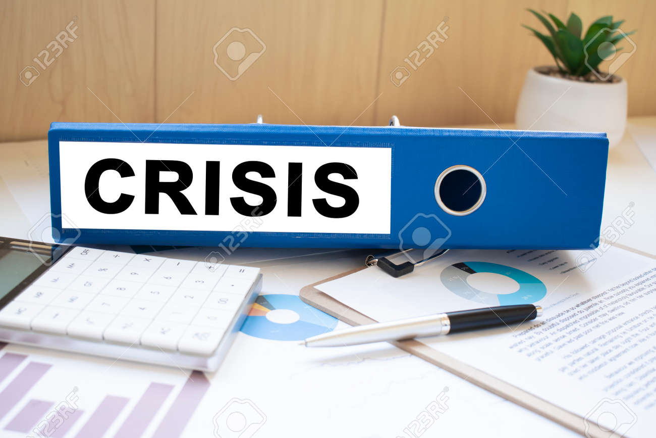 CRISIS words on labels with document binders - 173913509