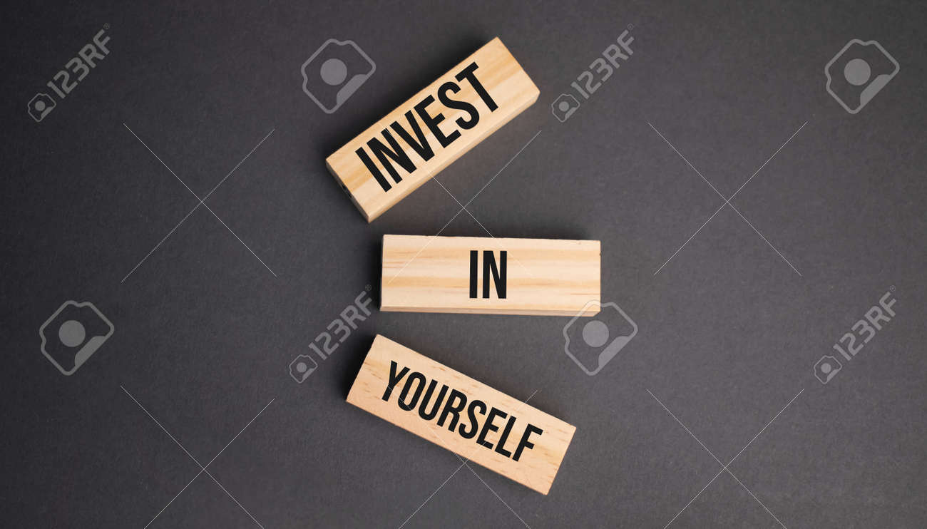 Invest in Yourself words on wooden blocks on yellow background. Business ethics concept. - 173913651