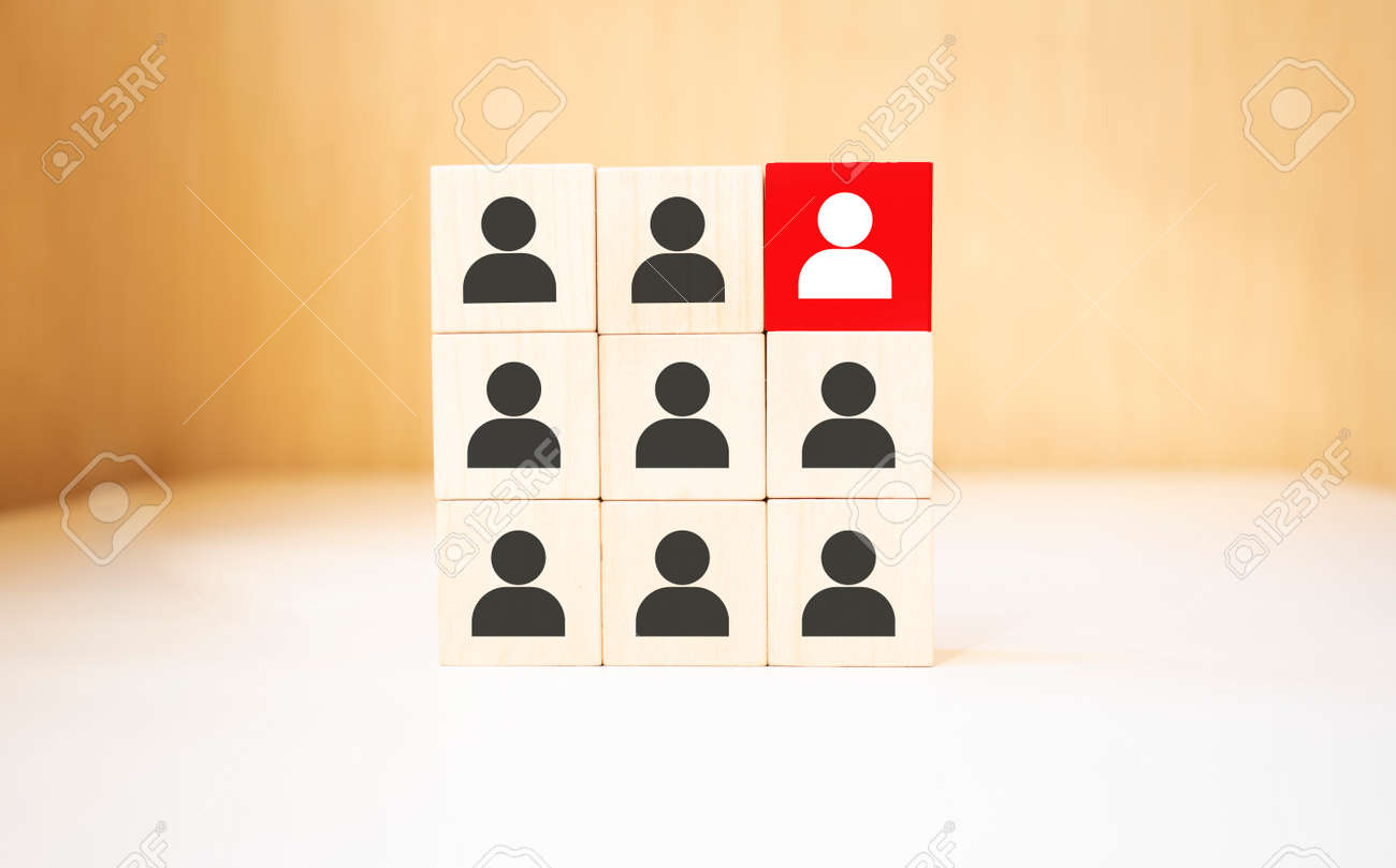 Human resource management and recruitment business concept, Hand putting wood cube block on top pyramid, Copy space - 174275492