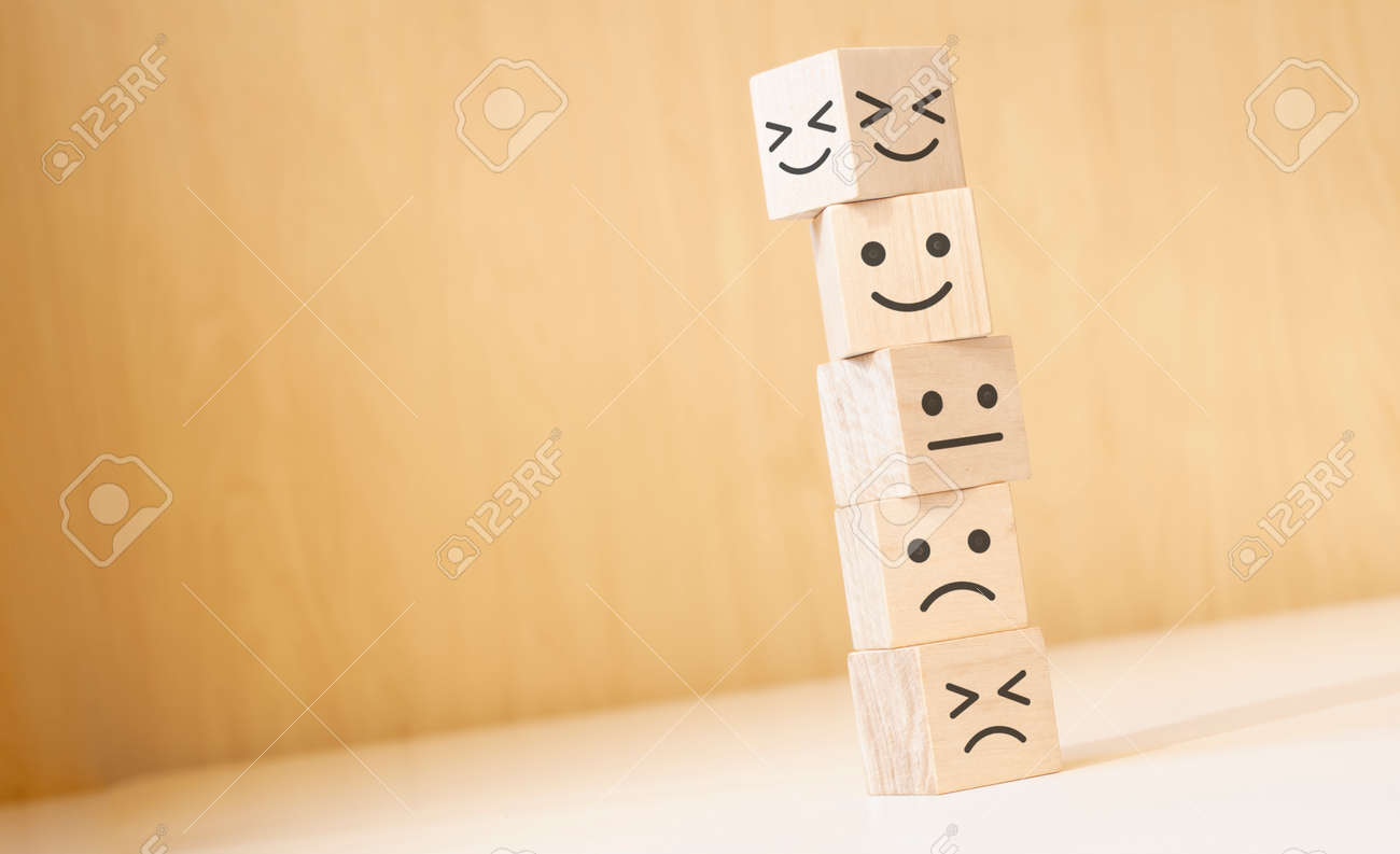 Wooden blocks with the happy face smile face symbol symbol on the table, evaluation, Increase rating, - 174275264