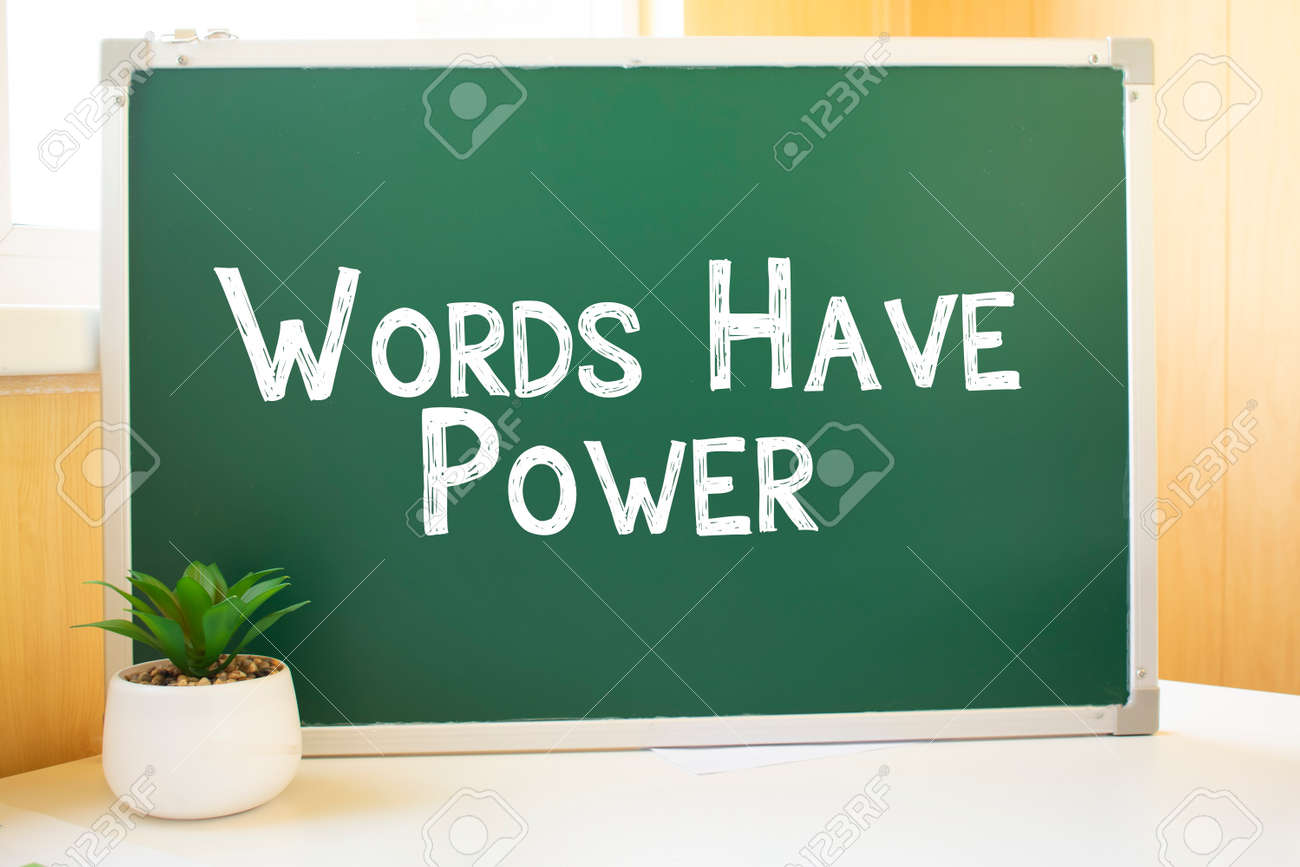 words have power inscription in chalk on the school board, Search engine optimization and websites. Desk, swept balls of paper, computer keyboard - 174274778
