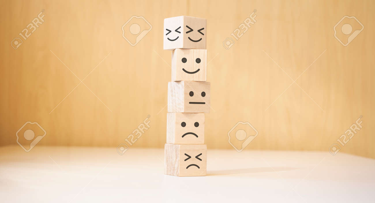 Wooden blocks with the happy face smile face symbol symbol on the table, evaluation, Increase rating, - 174274782