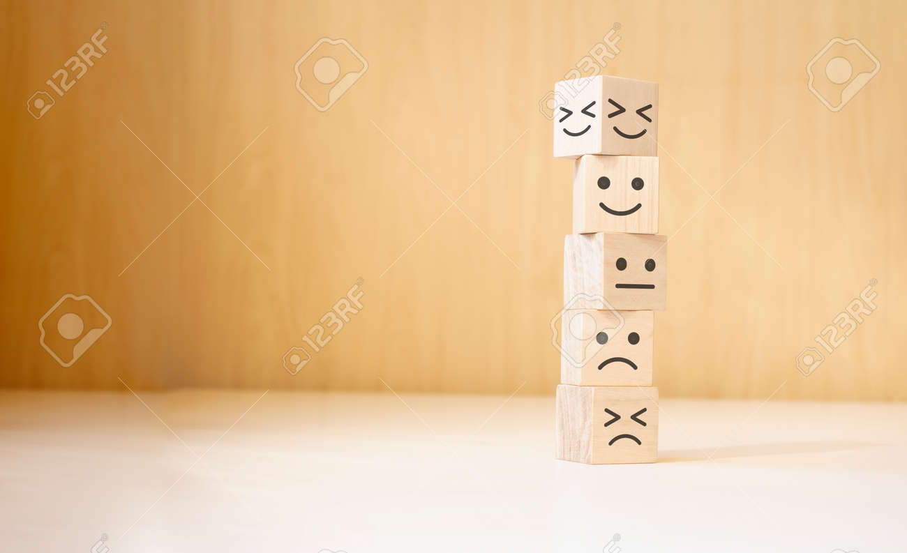 Wooden blocks with the happy face smile face symbol symbol on the table, evaluation, Increase rating, - 174274783