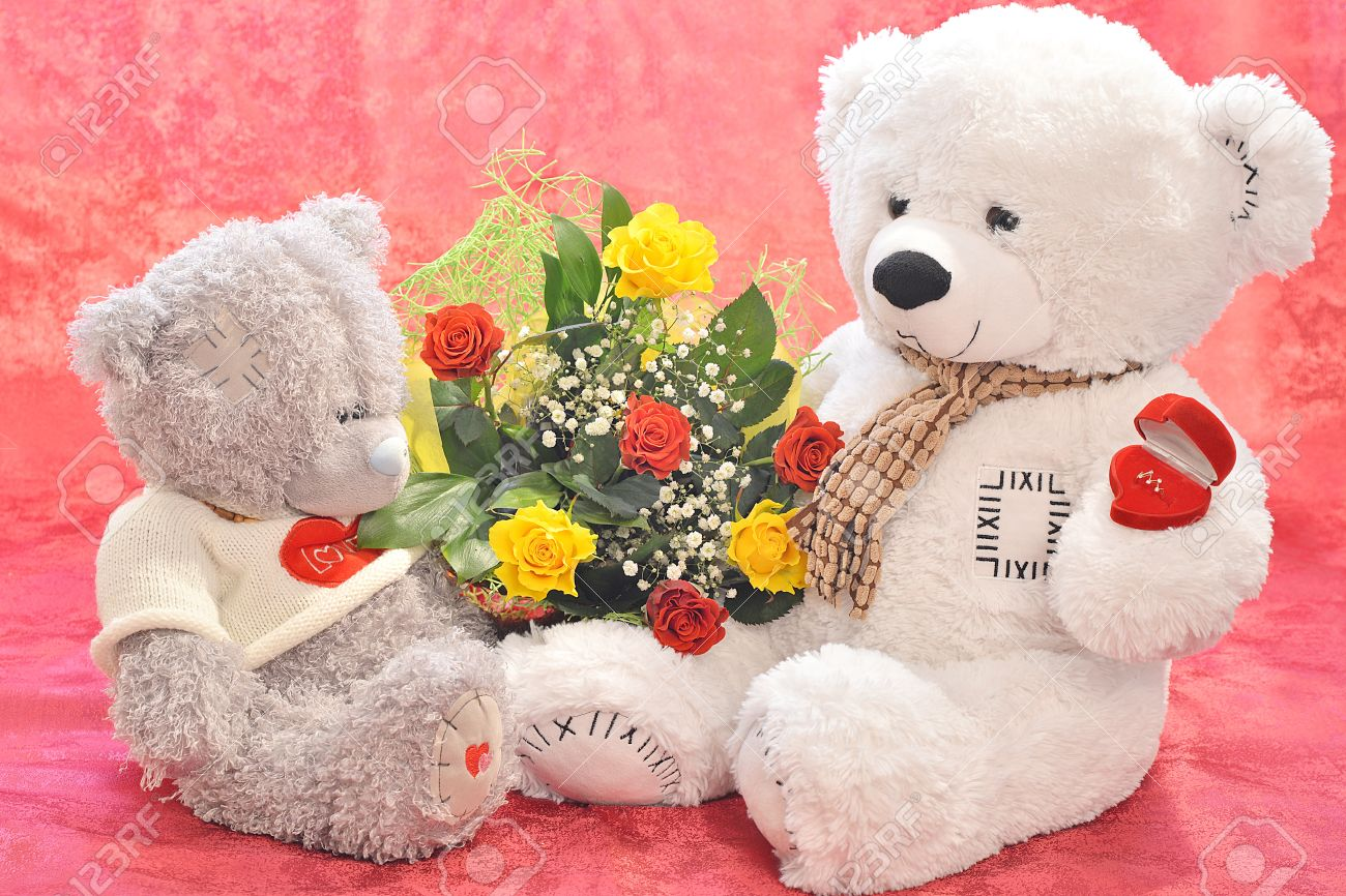 Teddy Bear With A Bouquet Of Flowers And A Gift Stock Photo, Picture ...