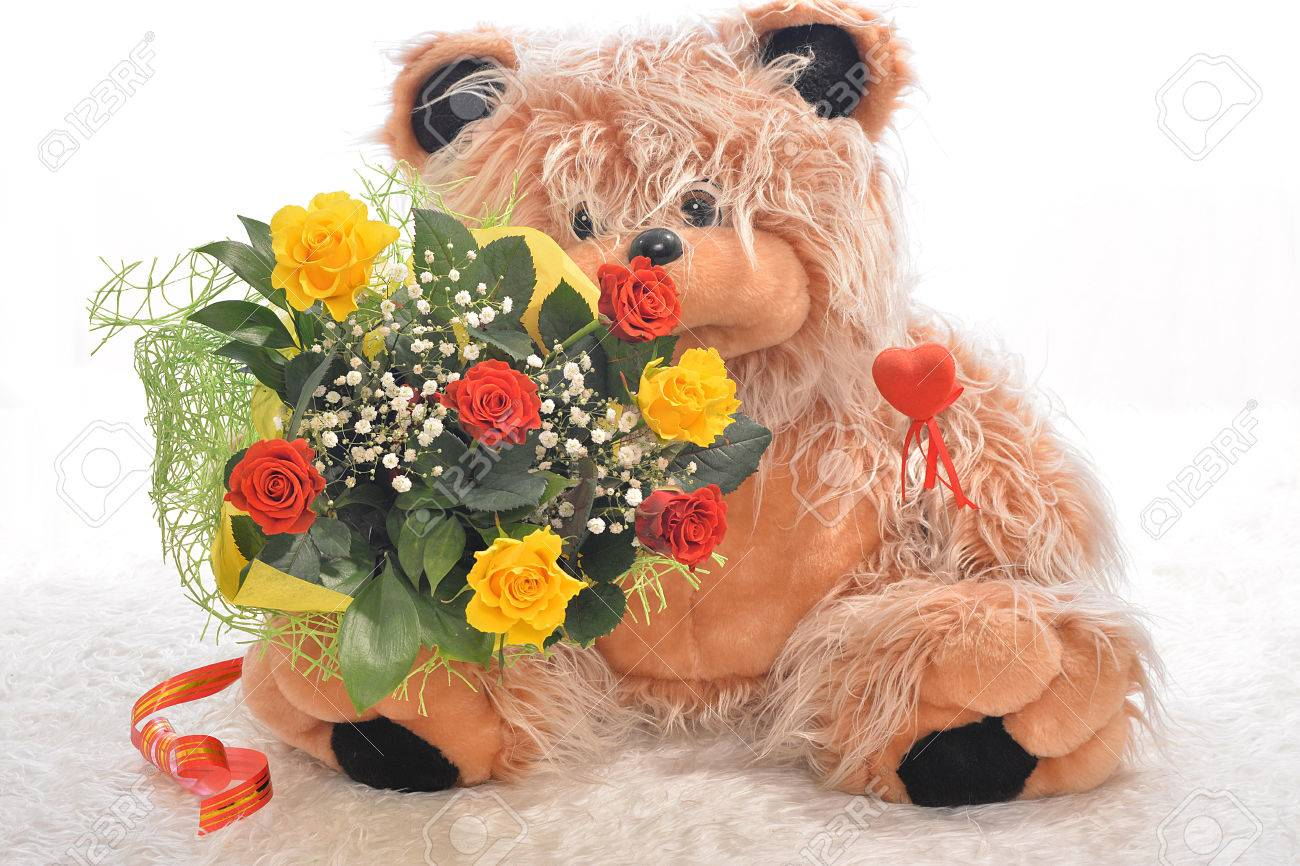 Teddy Bear With A Bouquet Of Flowers Stock Photo, Picture And ...