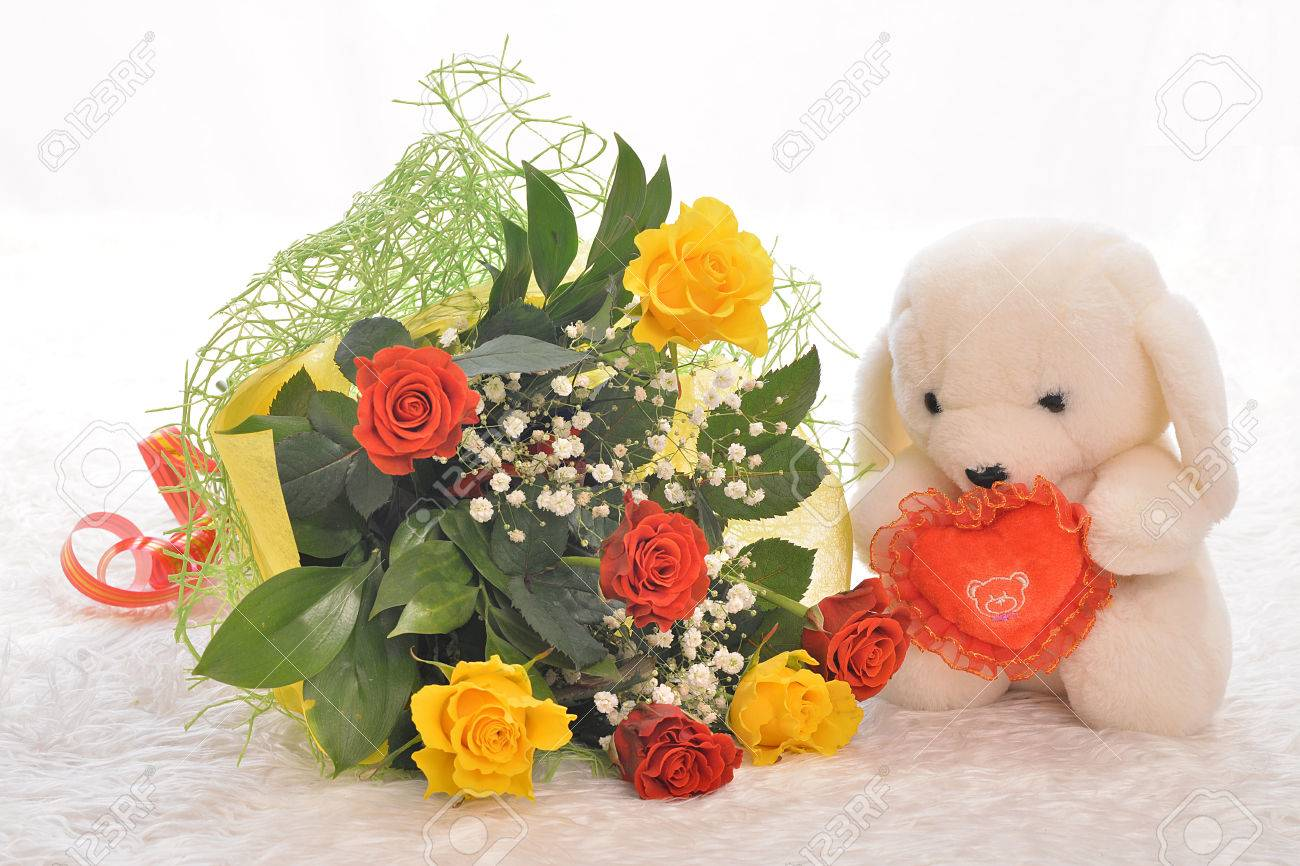 Teddy Bear With A Bouquet Of Flowers And Heart Stock Photo, Picture ...