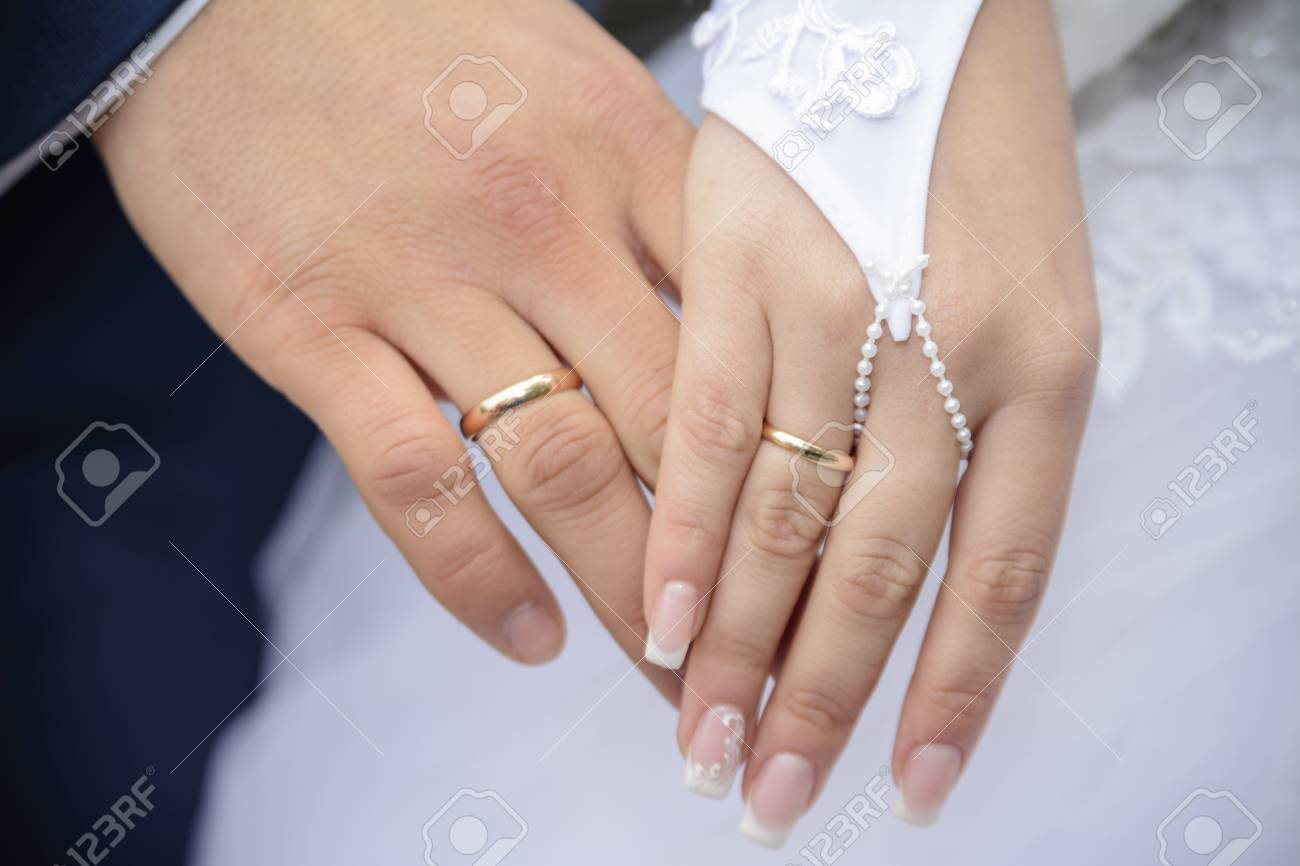 Male And Female Hand With A Wedding Rings Stock Photo Picture And