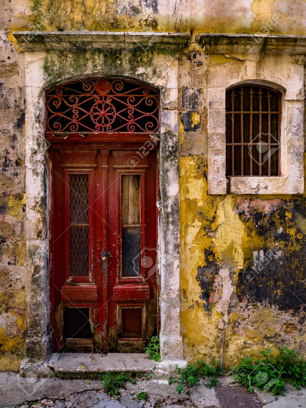 The Old Front Door In An Abandoned House Closeup. Decorative.. Stock House Door Grilles on
