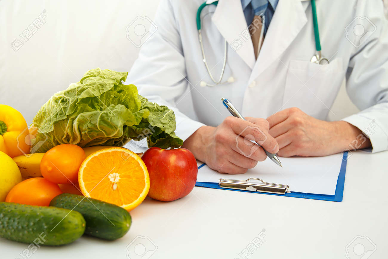 Nutritionist doctor writing diet plan on table. Right nutrition and slimming concept - 157760506