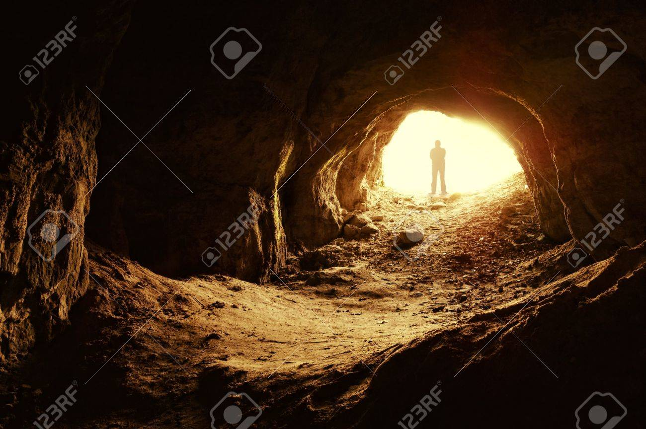 man standing in front of a cave entrance Stock Photo - 11386256