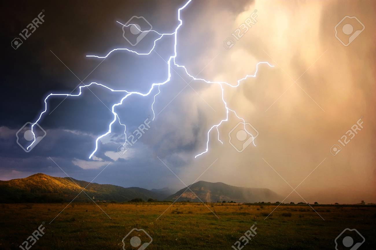 Lightning over the mountains with heavy rain and clouds Stock Photo - 18708462
