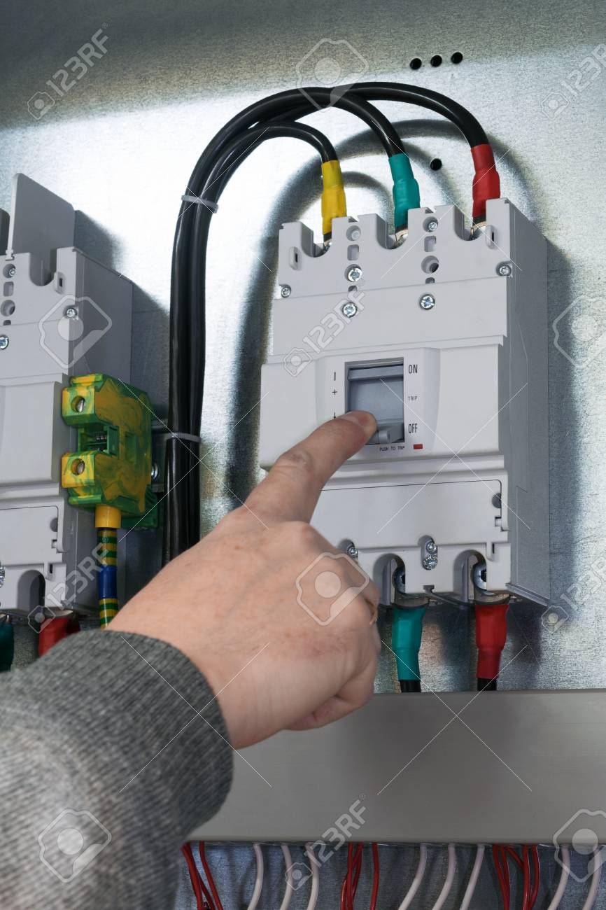 people hand off auto switch mounted in electrical Cabinet