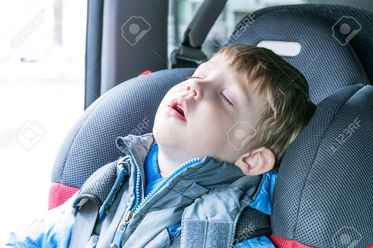Little Boy Sleeping In Child Car Seat The Chair Is Very Comfortable A