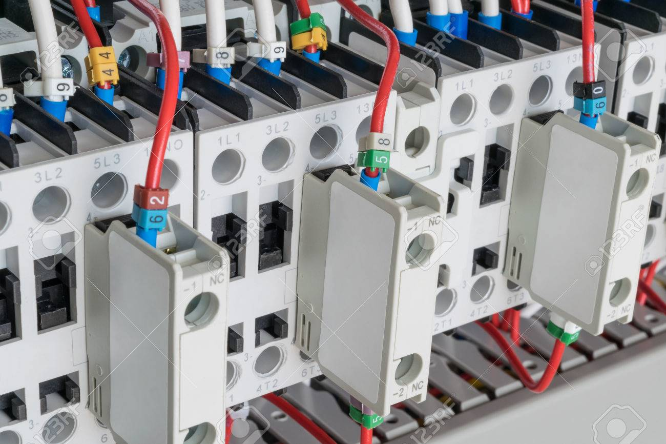 Several Contactors Arranged In A Row An Electrical Closet Wiring The Connected Wire Number