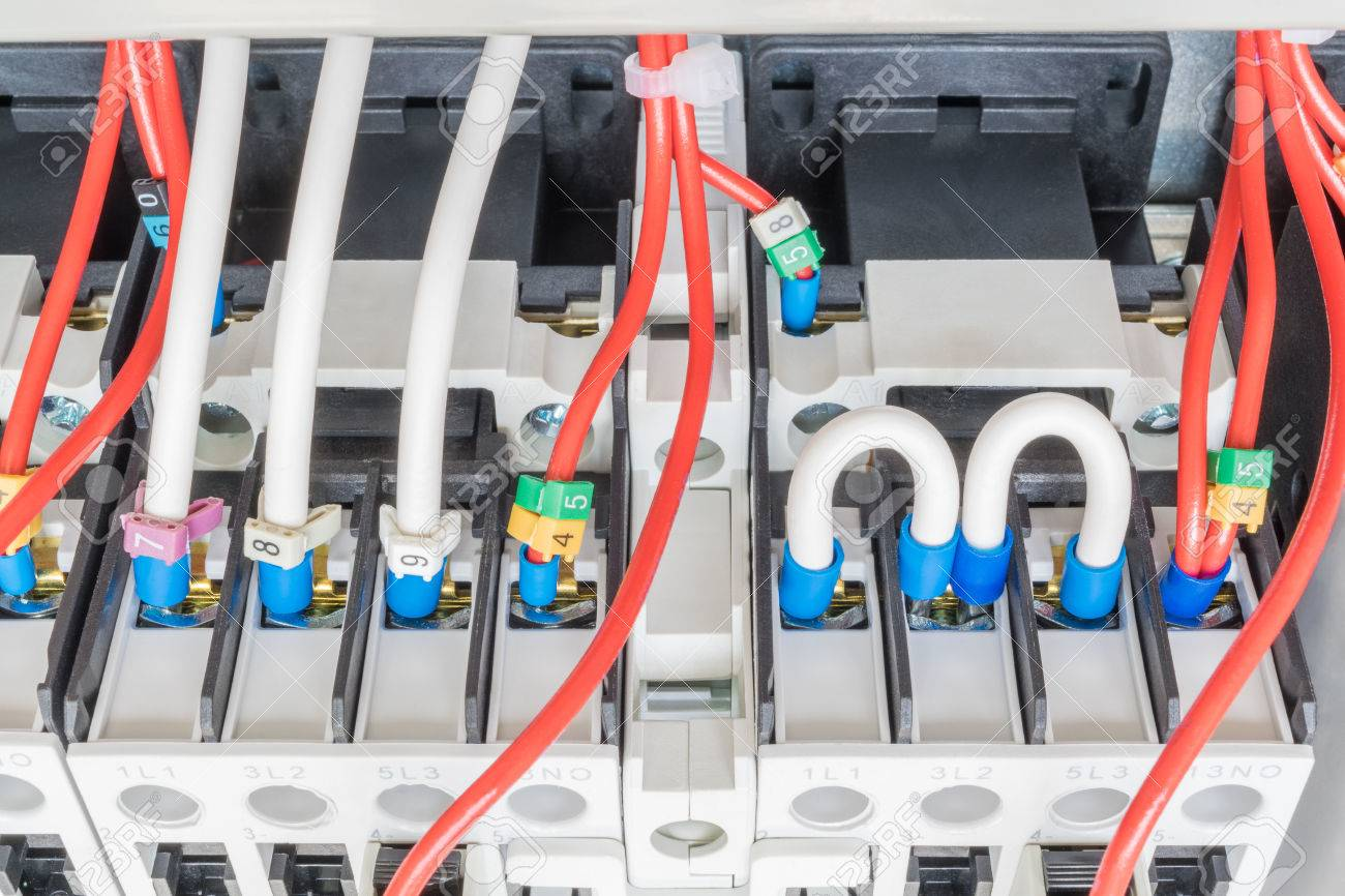 Several Contactors Are Mounted On Mounting Panel. To Them Attached ...