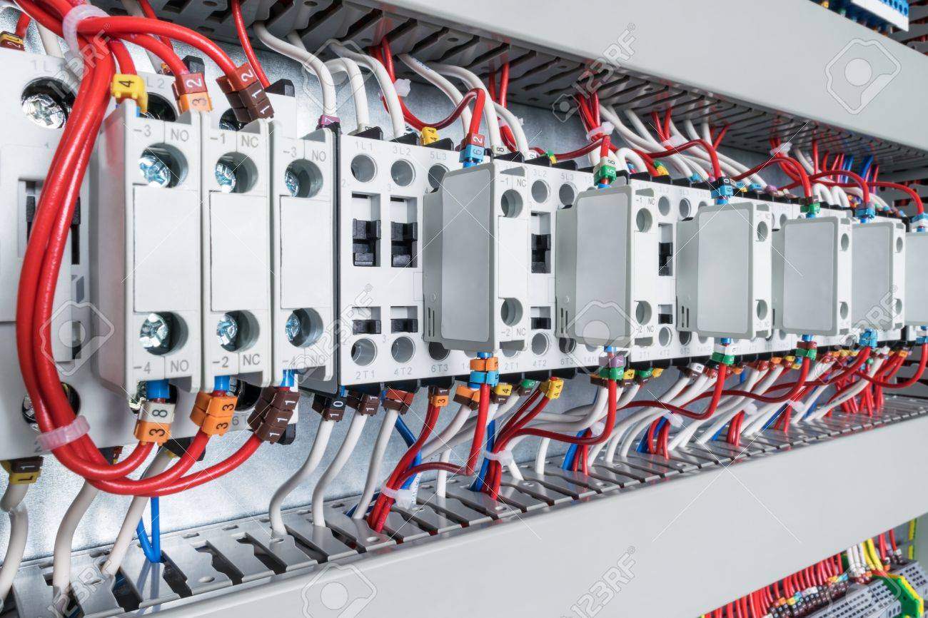 Several Contactors Arranged In A Row In An Electrical Closet ...