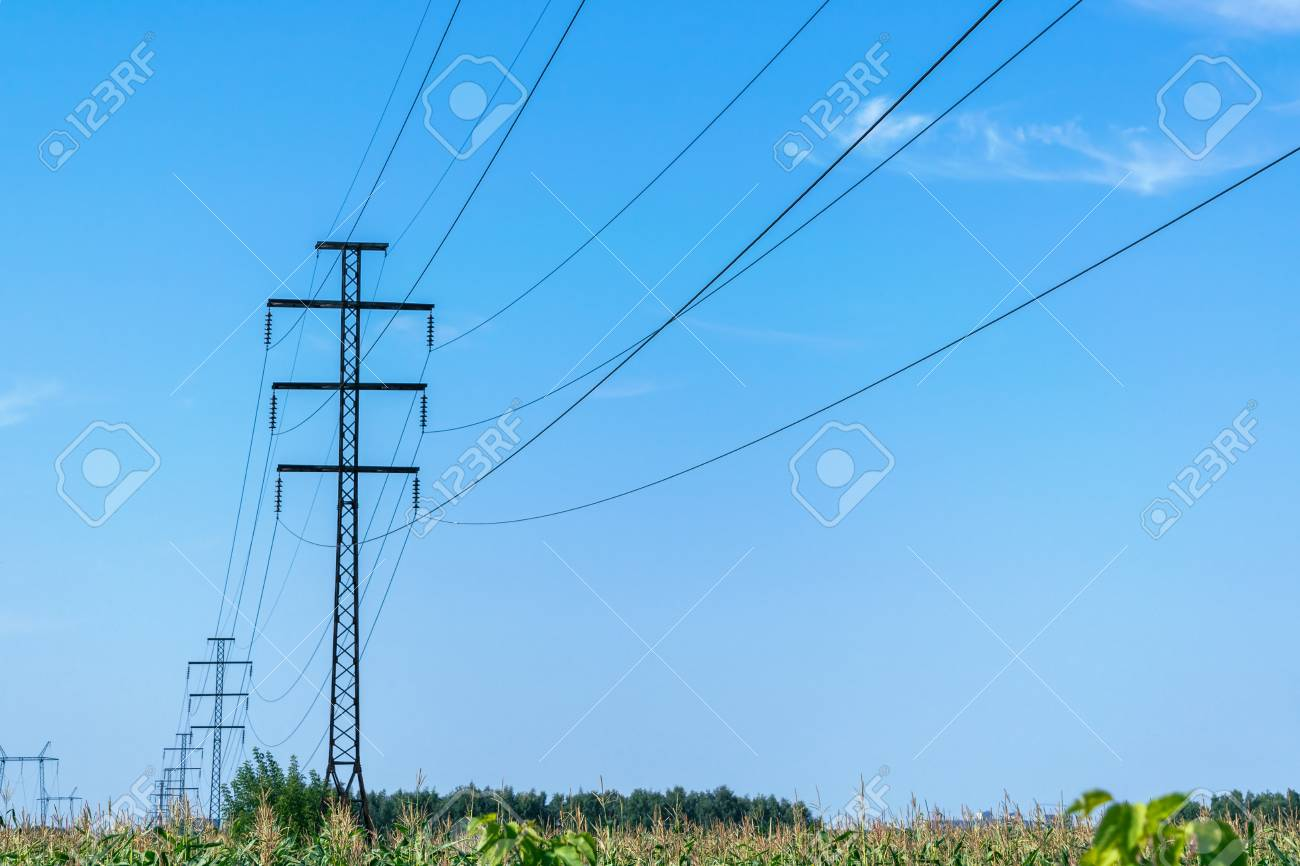 A number of high voltage poles leaving into the distance with