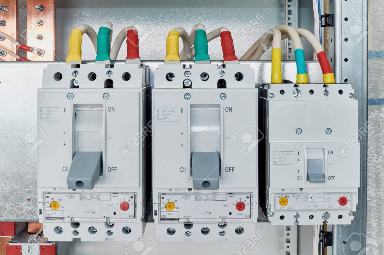 Power Circuit Breakers Are Arranged In A Row In An Electric Cabinet ...