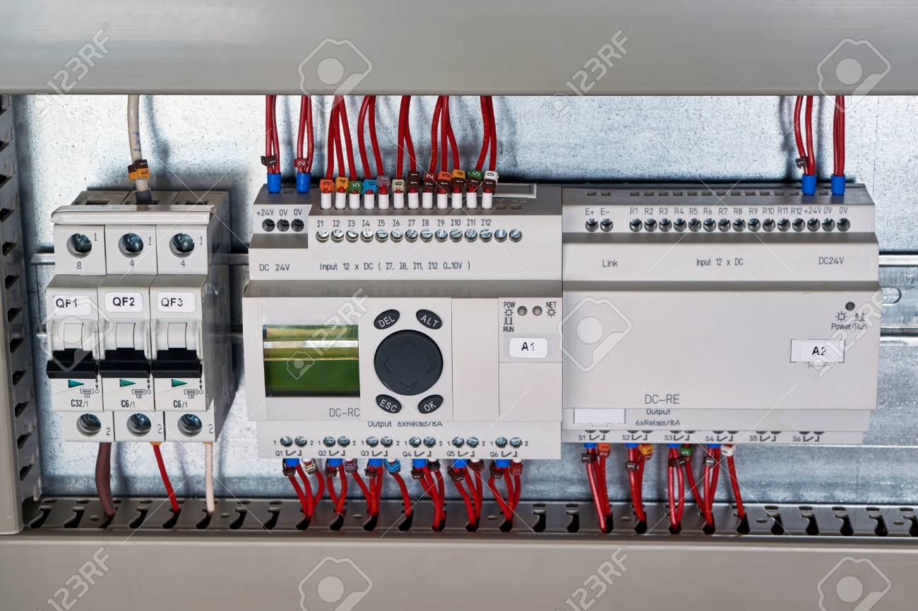 In The Electrical Cabinet Circuit Breaker Control Relay Expansion And Unit Controller With Liquid