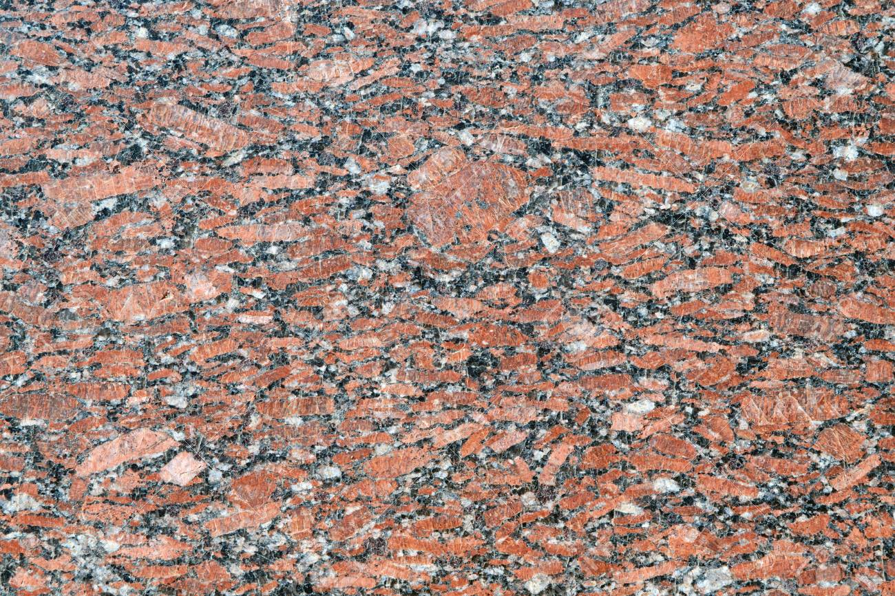 The flat surface of a natural marble or brown granite slab  On