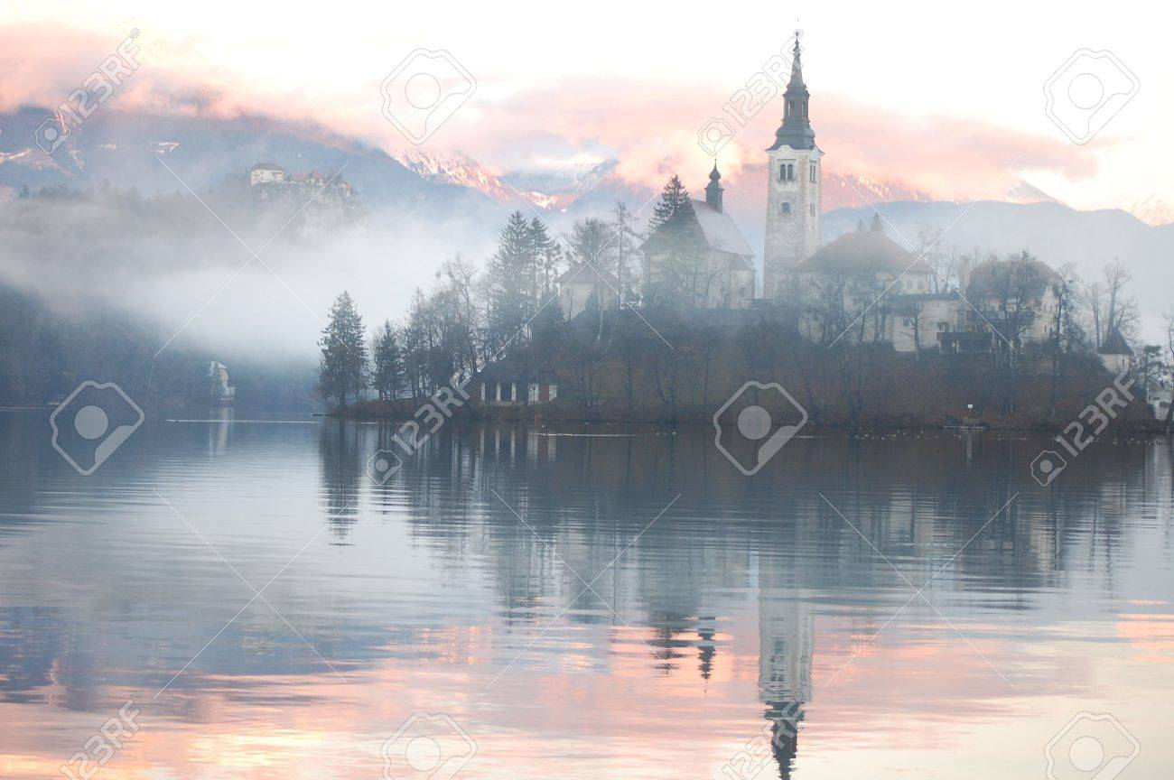 Misty evening at the Bled lake Stock Photo - 2335302