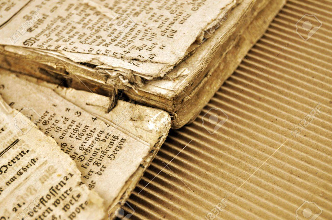 Detail of the very old book torn apart in sepia - 4466551