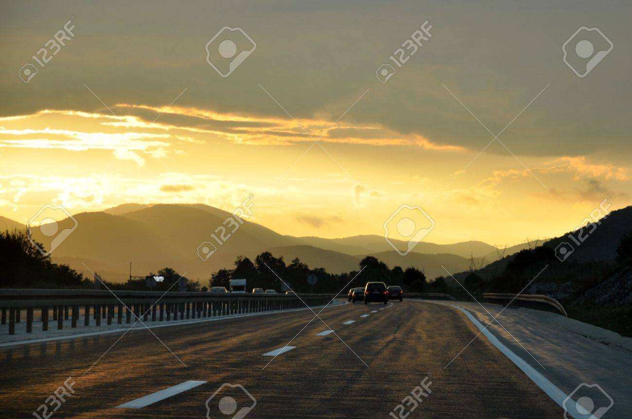 Cars driving on a highway at sunset Stock Photo - 7512551