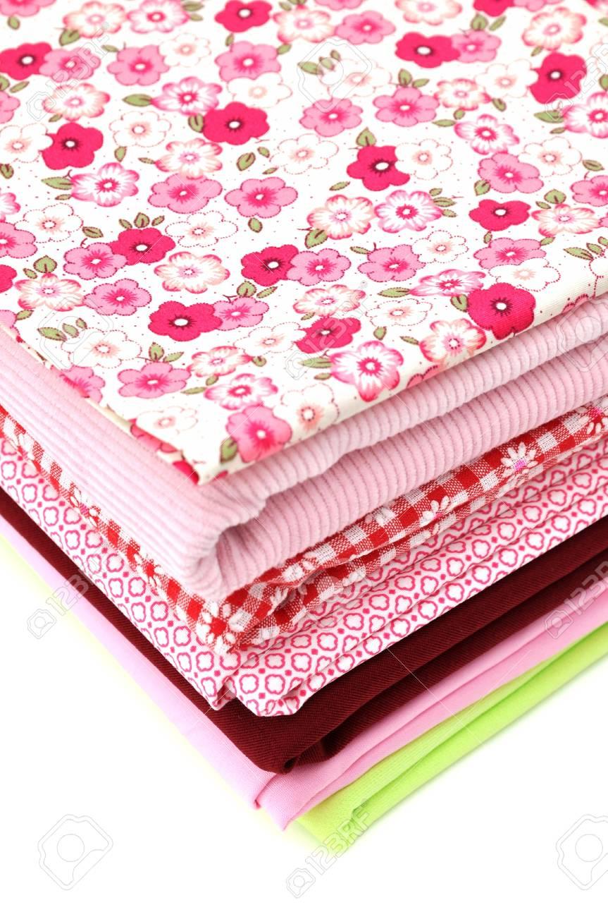 Pile of folded textile, isolated on white Stock Photo - 8392044