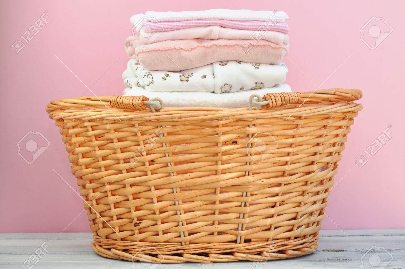 Laundry Basket Full Of Ironed Pink Baby Clothes Stock Photo Picture