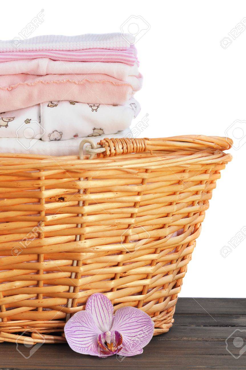 Laundry Basket Full Of Ironed Pink Baby Clothes Isolated On Stock