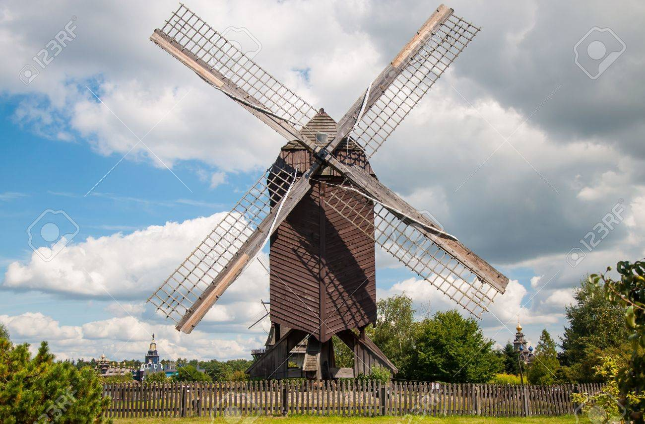 Mill in summer day against the sky Stock Photo - 15768328