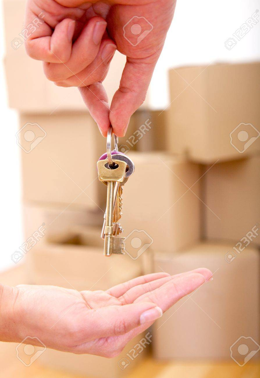 Sensational Person Handing Over The Keys Of A New House Moving Concepts Foto Largest Home Design Picture Inspirations Pitcheantrous