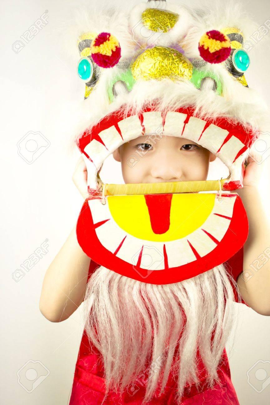 Boy New Year celebration with Lion Dance Standard-Bild - 12061316