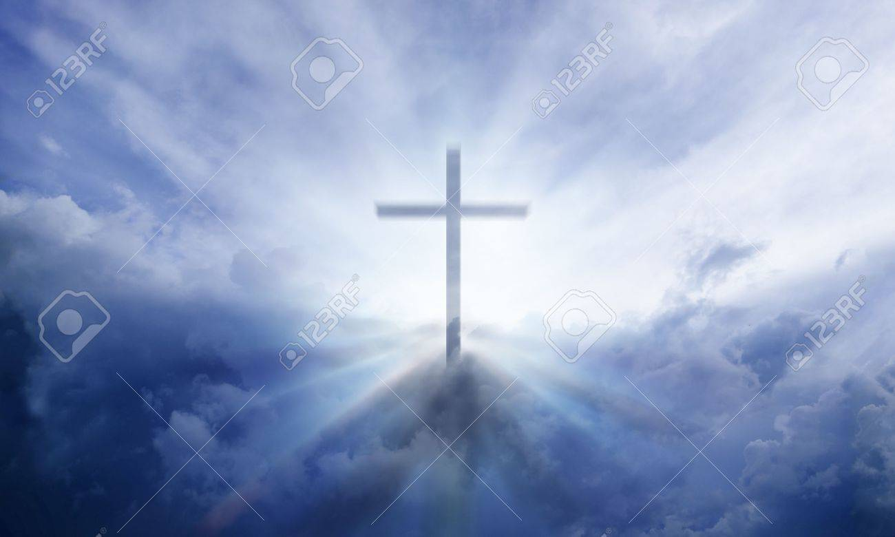 A transparent Cross giving out heavenly light in the sky Standard-Bild - 14480531