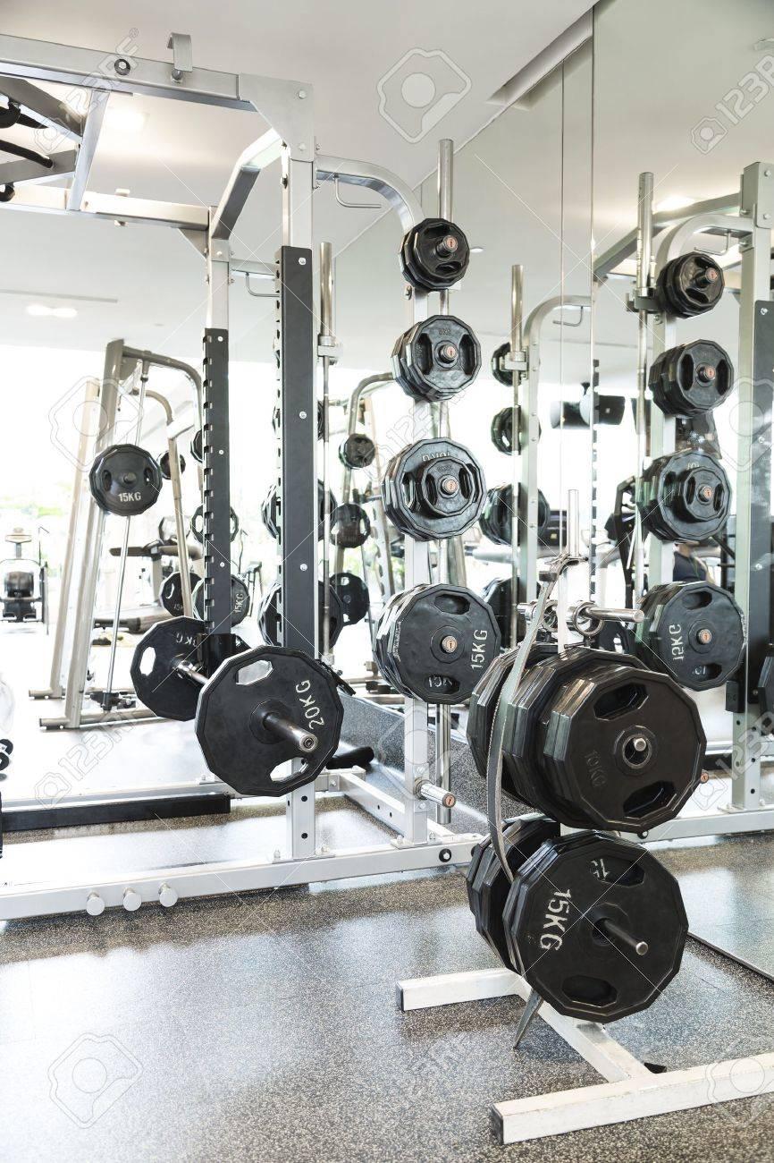 Weight lifting equipments in a club gym Standard-Bild - 21303406