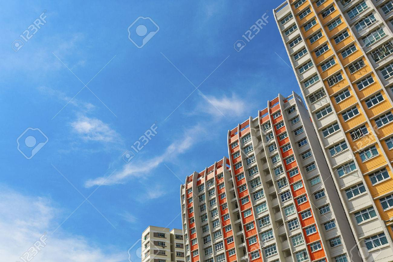 A low angle shot of a new colorful high rise apartment against the sky Standard-Bild - 22874632