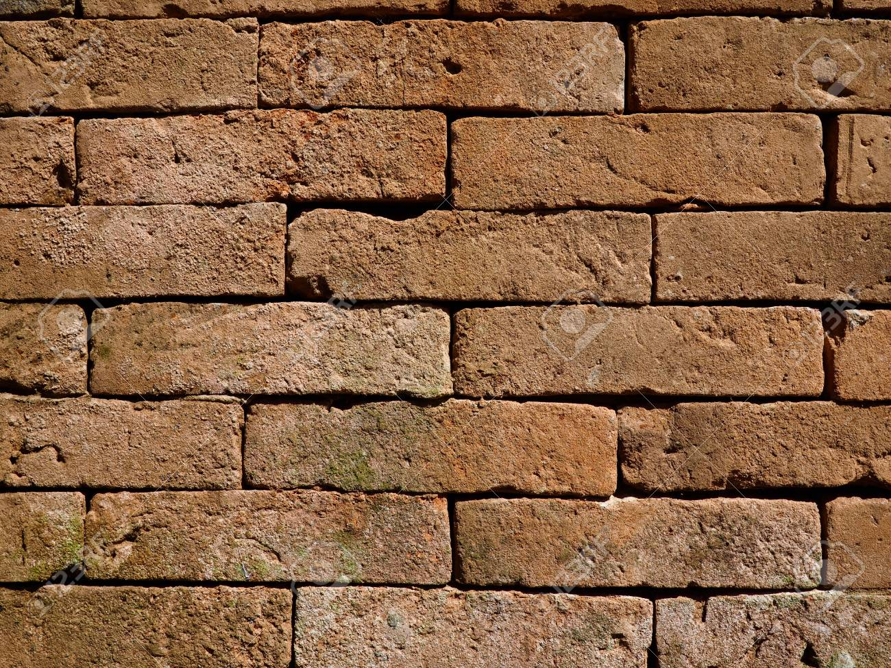 Brick Wall Built With No Mortar Forming A Textured Background