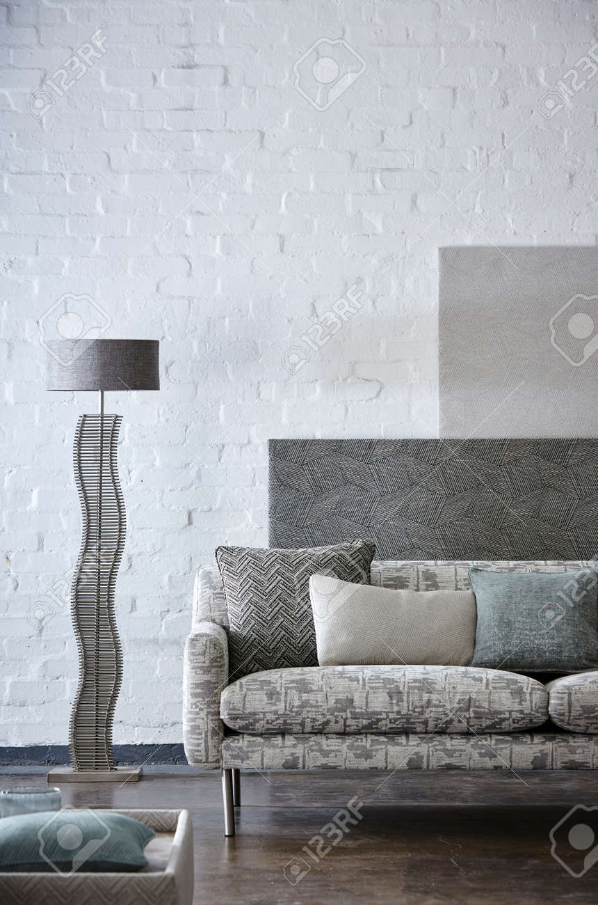Shot of grey color armchair with pillow on hardwood floor - 150808141