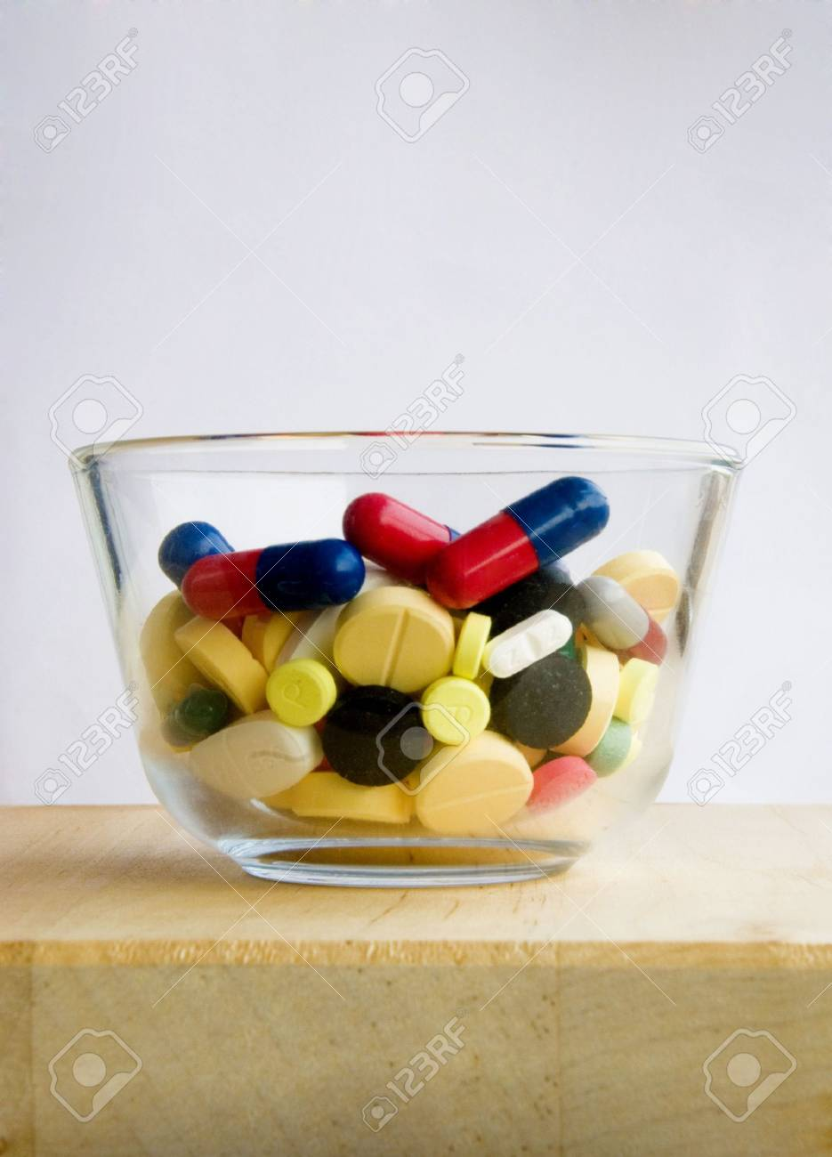 Glass filled fully with medication pills Stock Photo - 3268560