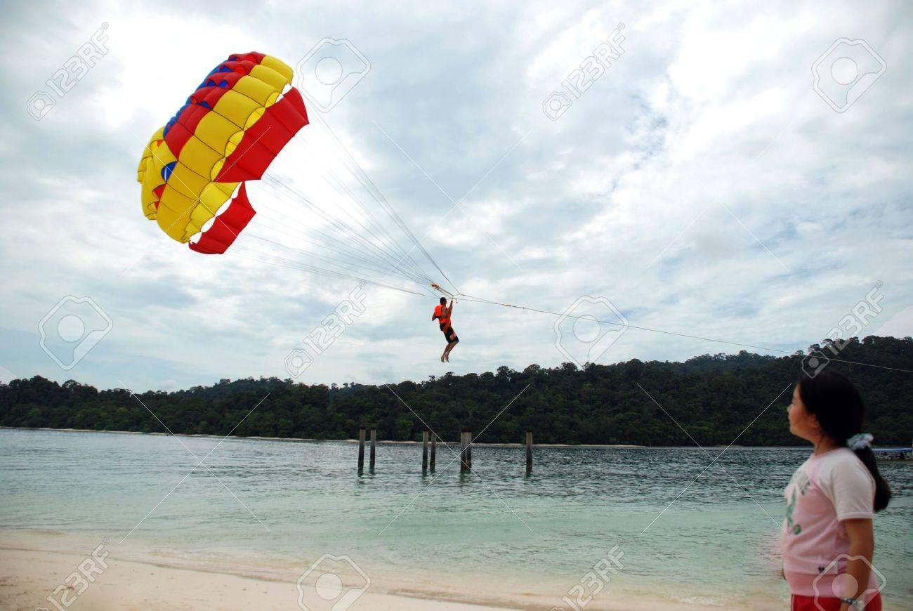 Parachuting beach sports - young asian girl looking Stock Photo - 4142788