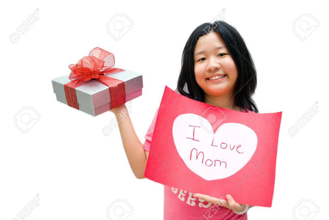 Girl in pink shirt, with i love mom message board on white background Stock Photo - 4411571