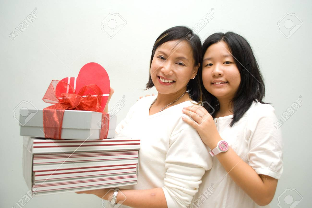 Mother and daughter posing with stack of gifts Stock Photo - 4426788