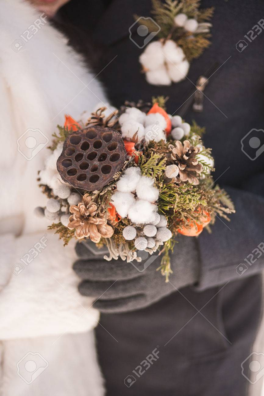 Beautiful Winter Bridal Wedding Bouquet In Hands Of Bride And ...