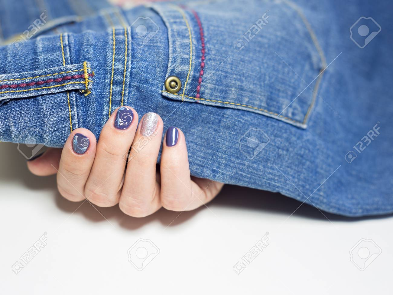 Close Up Of Female Hands With Professional Blue And Silver Manicure ...