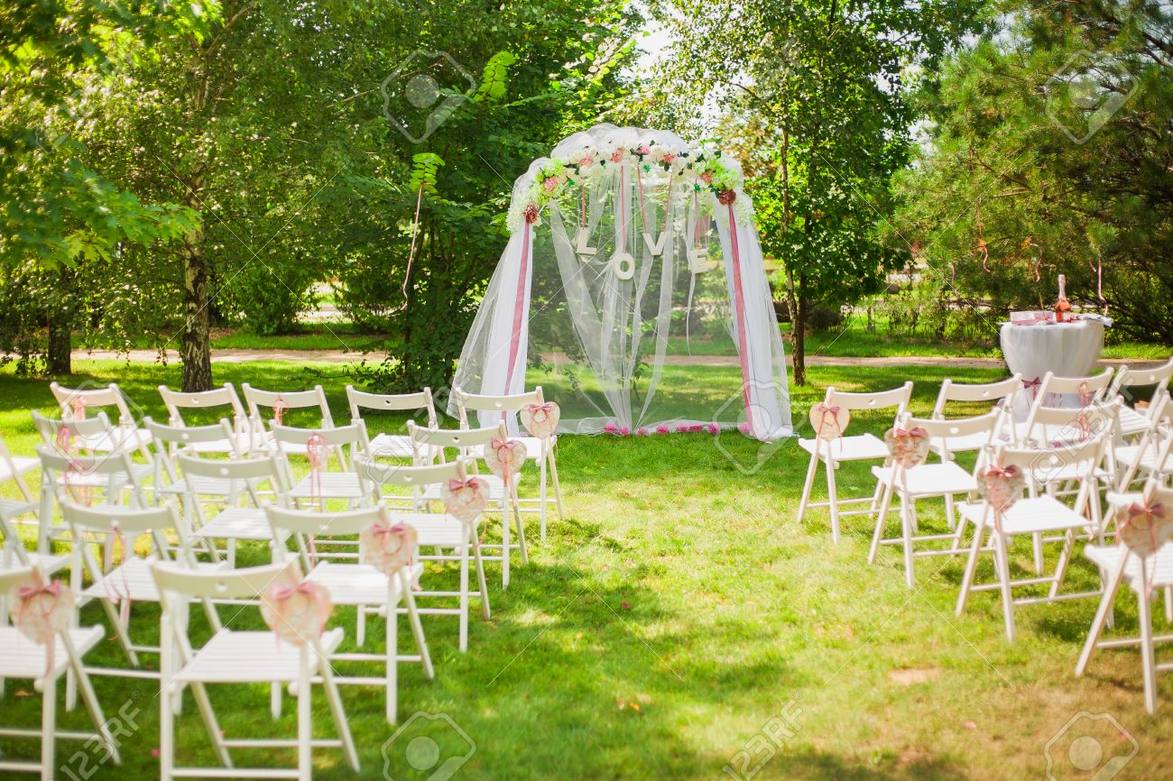 Beautiful place for outside wedding ceremony in city park many beautiful place for outside wedding ceremony in city park many white wooden chairs decorated stock junglespirit Gallery