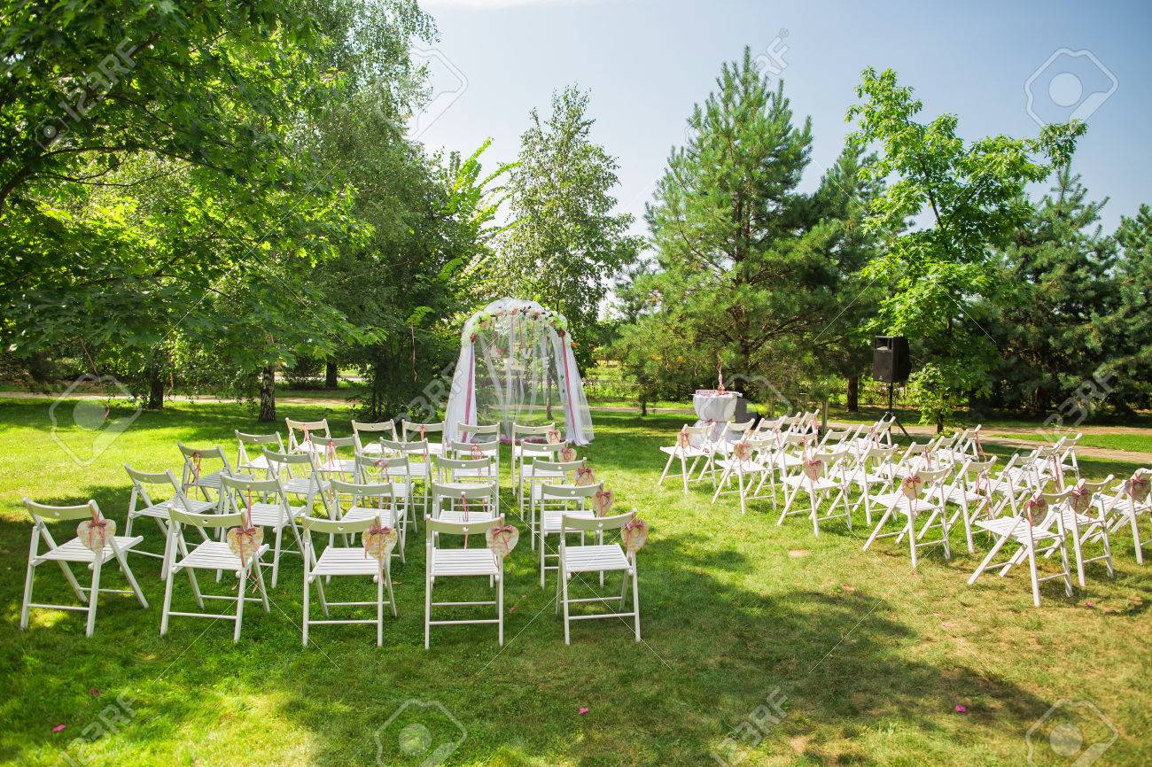 Beautiful place for outside wedding ceremony in city park many beautiful place for outside wedding ceremony in city park many white wooden chairs decorated stock junglespirit Choice Image