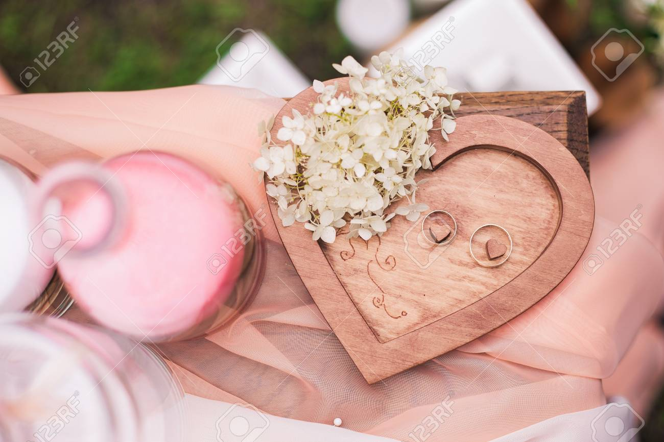 Closeup Top View Of Two Golden Wedding Rings On Wooden Heart.. Stock ...