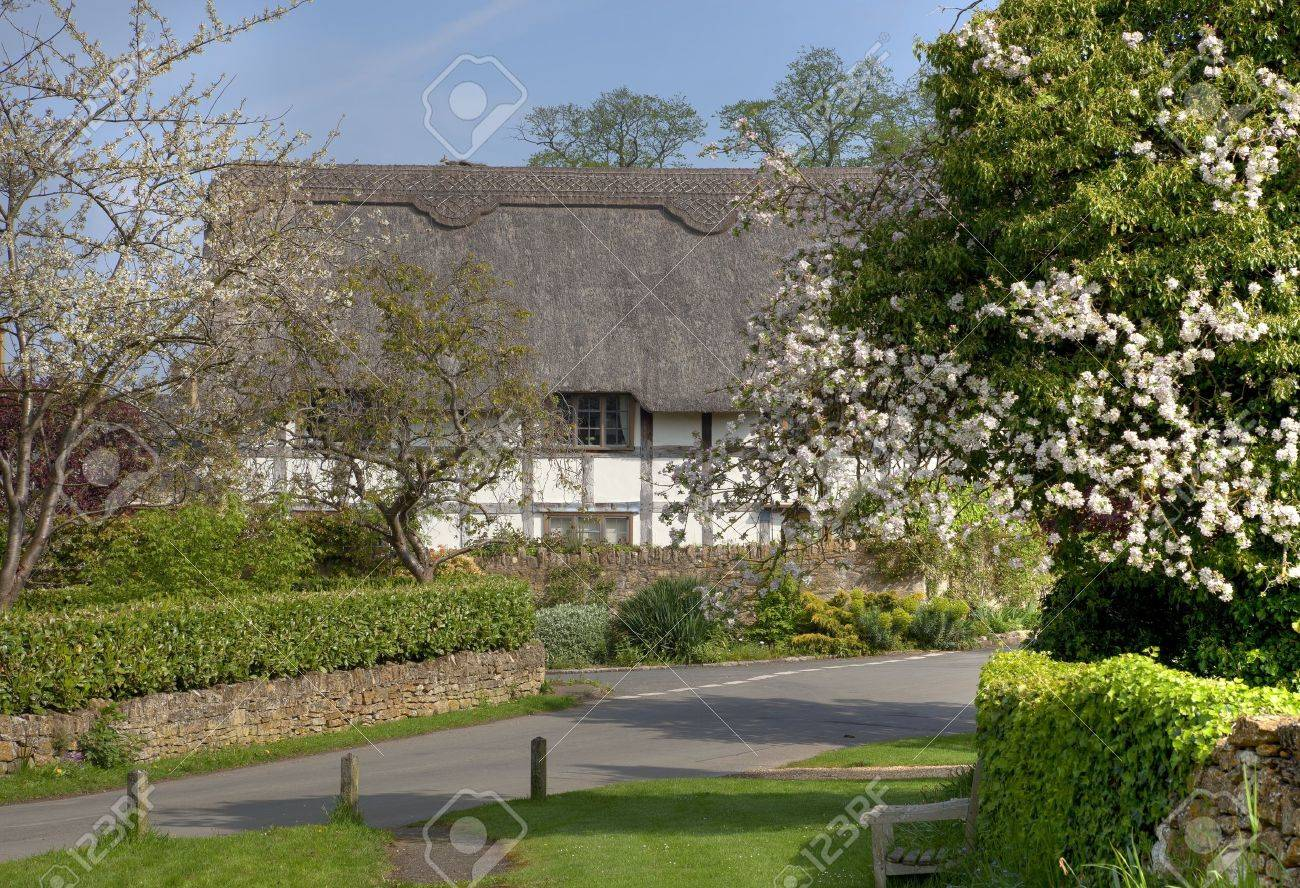 Black And White Thatched Cottage In The Cotswold Village Of Stanton Gloucestershire England