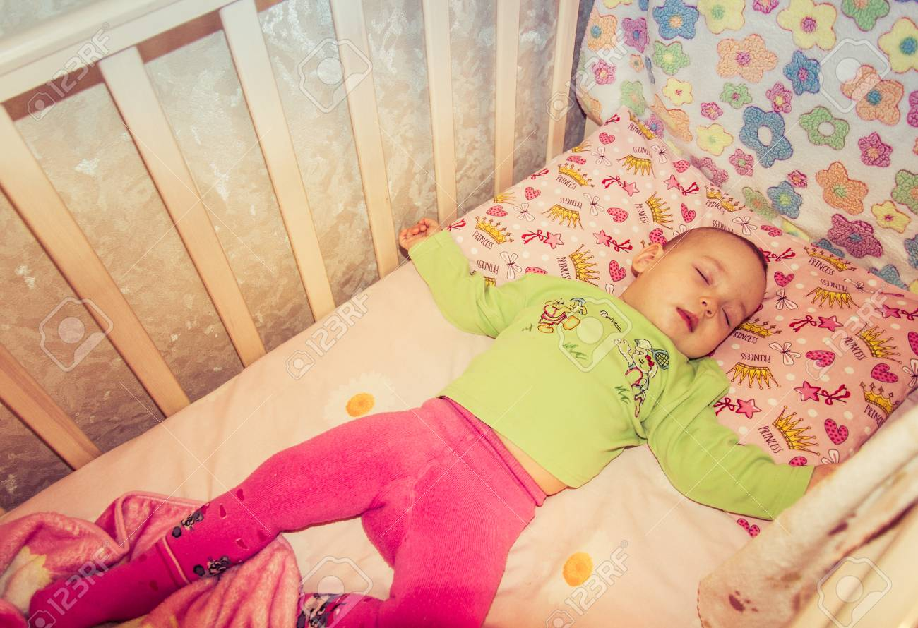 very nice sweet baby sleeping in crib stock photo, picture and
